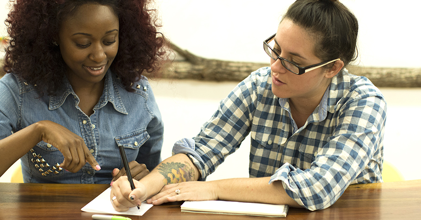 L to R: Students Shenice Brotherson and Lauren Kimrey-Sanders work on a project at Miami Ad School @ Portfolio Center.