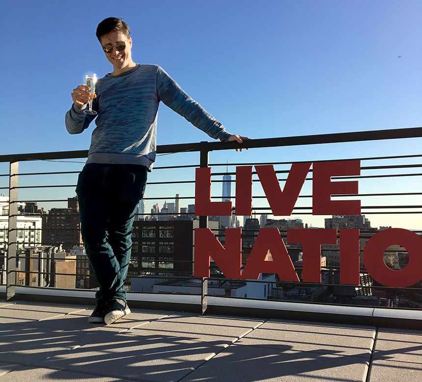 Miami Ad School art direction graduate GT Smith toasts his new career on the rooftop of Live Nation headquarters in New York City.