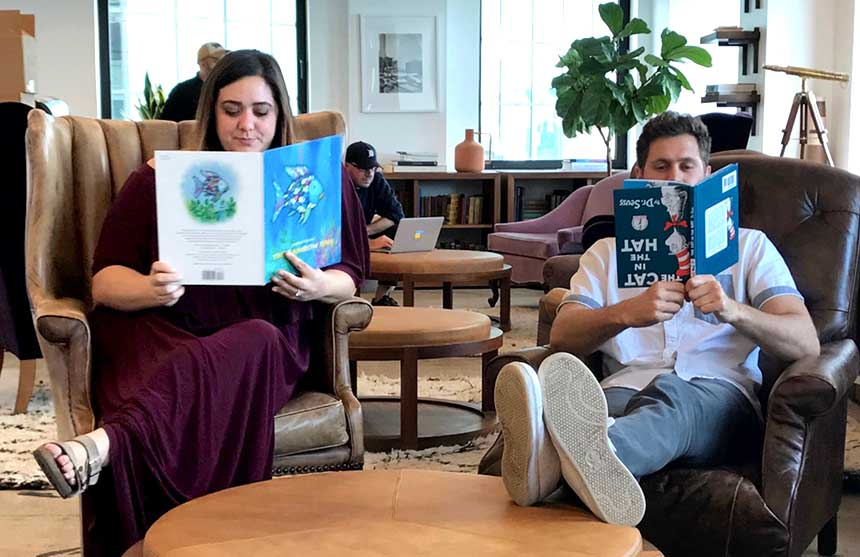 Taking a quick break in the Droga5 library. L to R: art direction student Stephanie Armstrong and copywriting student Dave Adams.